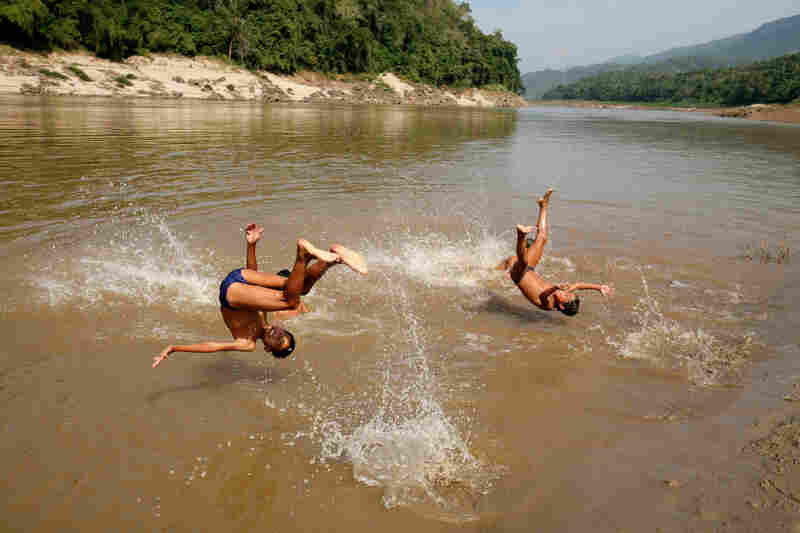 Laotian children jump into the Mekong River north of Luang Prabang, the country's ancient royal capital.