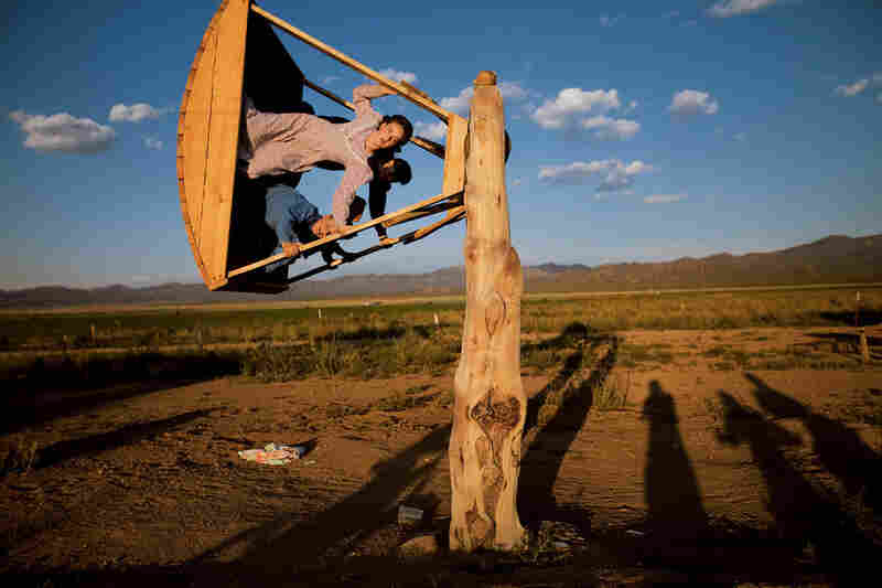 After helping with the hay harvest, Amber Barlow, 16, soars on a homemade swing with friends at the 4,000-acre FLDS ranch in Pony Springs. FLDS members, even young children, are expected to help with chores throughout the year.