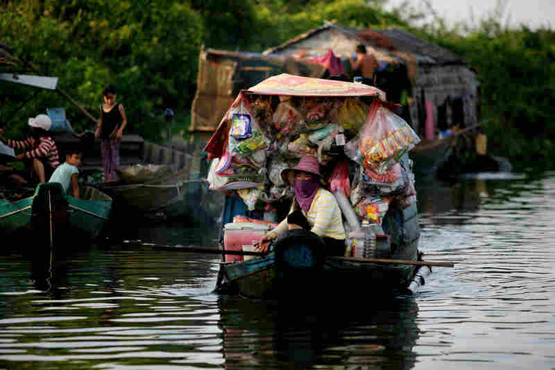 A merchant travels the waterway through a floating village inhabited mostly by ethnic Vietnamese fishermen on the Tonle Sap Lake, outside Siem Reap.
