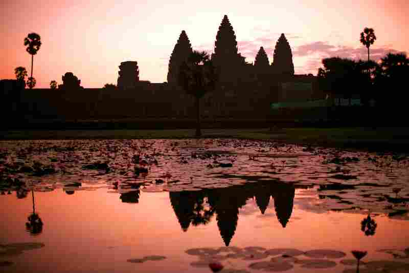 The sun rises over the Angkor Wat temple near Siem Reap in northwest Cambodia. The temple was the crowning architectural achievement of the powerful Khmer kingdom, which ruled between the ninth and 15th centuries.
