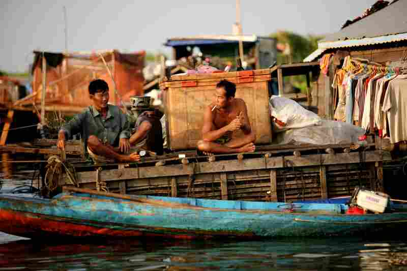 Fisherman are seen at a floating village along the Tonle Sap Lake. The villages on the water contain not only housing, but shops, schools, clinics, and  gas stations and convenience stores.