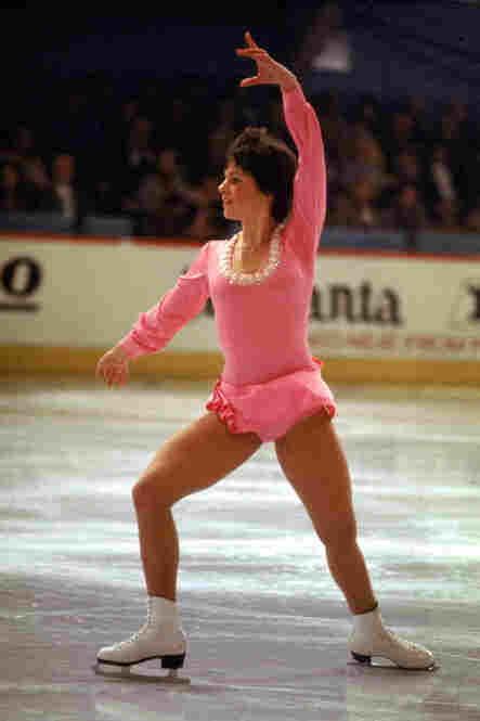 Dorothy Hamill, better known for her wedge haircut than her costumes, won a gold medal for the U.S. in the 1976 Olympics. It was one of the last Olympics where costumes were still homemade. Hamill said in an interview her Olympic dress, made by a friend's mother, cost $75. This photo is from the previous year's World Championships.