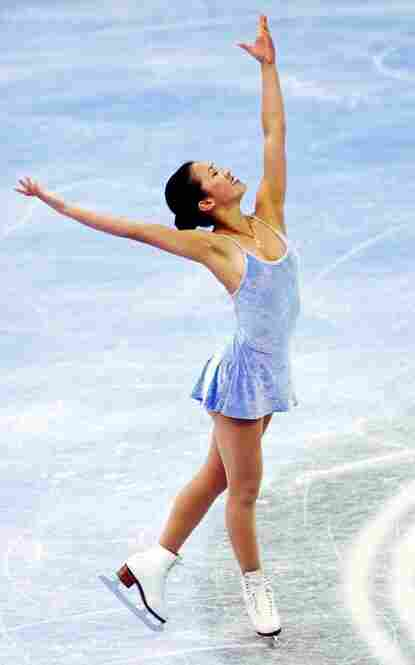 American Michelle Kwan, often considered the greatest figure skater never to have won an Olympic gold medal, had many of her costumes designed by Vera Wang. She competed in this periwinkle dress (not designed by Wang) in the 1998 Olympics.