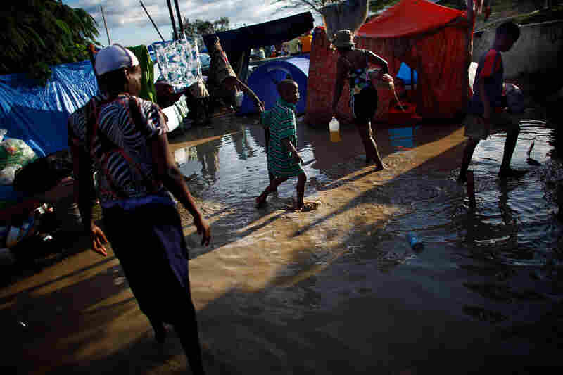 Families collect their belongings and begin moving out of their camp, flooded with waters containing sewage runoff. Aid organizations and government officials are scrambling to avoid a catastrophe when the rainy season intensifies.