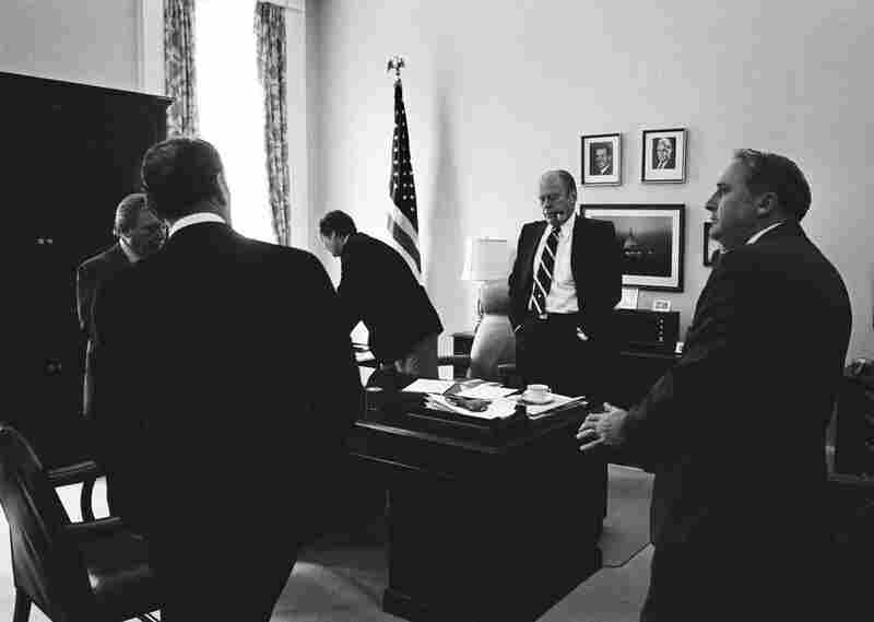 After Nixon resigned in 1974, Haig stayed on as White House chief of staff to ease President Ford's transition into office.  Moments after Ford pardoned Nixon, he and his staffers — including Haig (whose back is to the camera) — were met with a critical response from Congress.