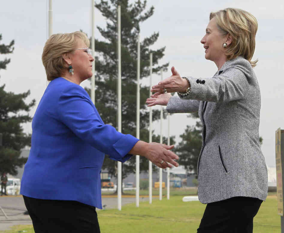 Secretary of State Hillary Clinton is greeted by Chilean President Michelle Bachelet at the airport in the capital, Santiago, on Tuesday.