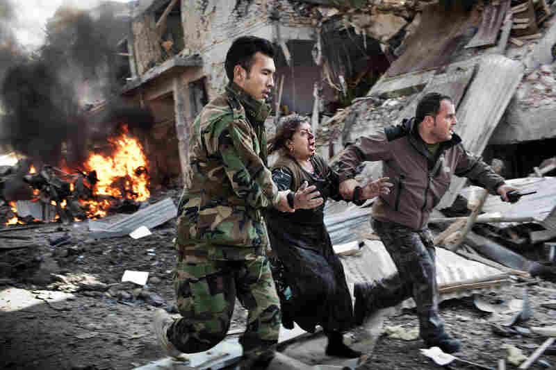 Spot news singles, 1st prize: Afghan woman rushed from the scene of a suicide bombing, Kabul, Dec. 15, 2009.