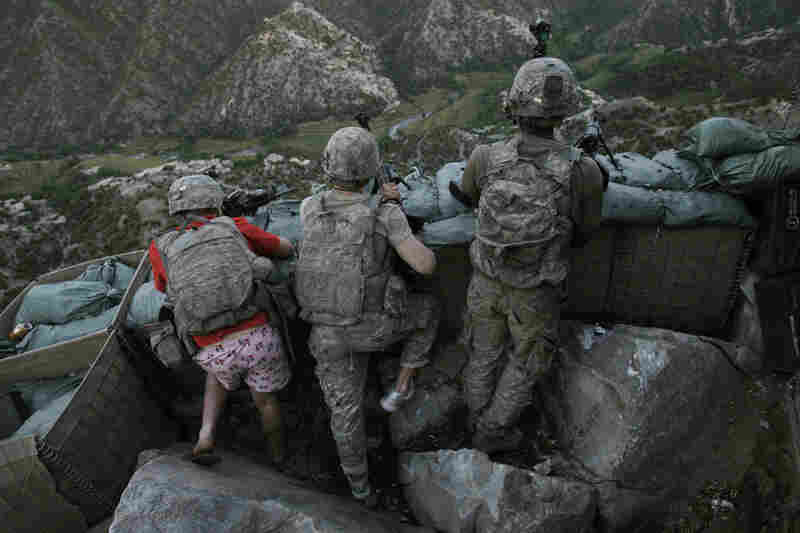 People in the news singles, 2nd prize: U.S. soldiers respond to Taliban fire outside their bunker, Korengal Valley, Afghanistan, May 11