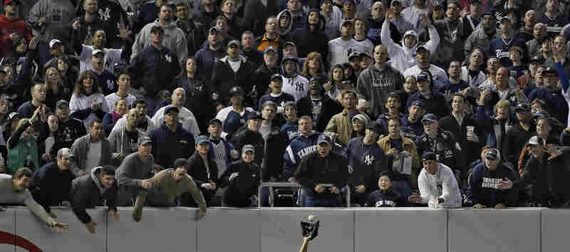 Sports features singles, 1st prize: Yankee fans try to distract Angels left fielder Juan Rivera, Yankee Stadium, 25 Oct.