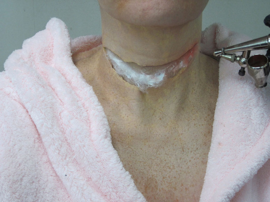 "Cotton is placed into the slit of the latex, so that makeup artist Jerry Constantine can prepare the neck for what he calls ""the meat"" -- the innards of the wound."