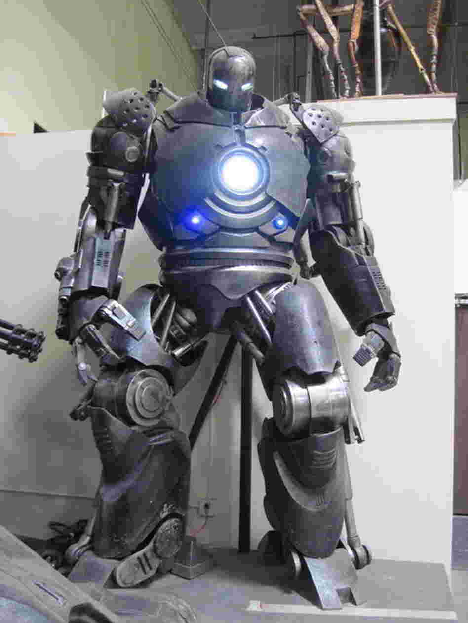 The Iron Monger's armor from Iron Man stands menacingly in the Legacy warehouse.