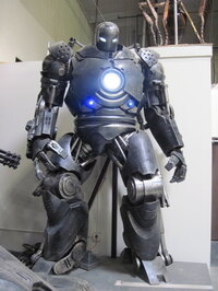 The Iron Monger's armor from <i>Iron Man</i> stands menacingly in the Legacy warehouse.