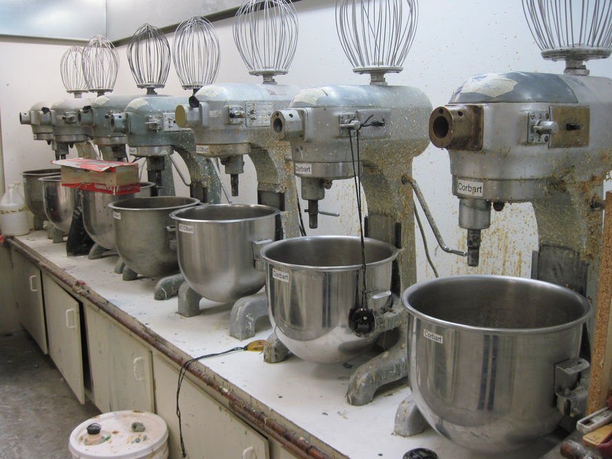 Seven mixers sit at the ready in a climate-controlled room. They are used for mixing foam -- the first stage for making glue-on prosthetic devices.