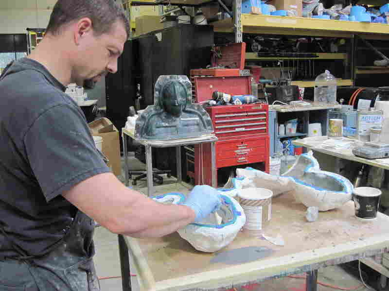 The mixed foam is then set in molds, baked and peeled out.  Here, a technician constructs facial parts for the upcoming film Thor.