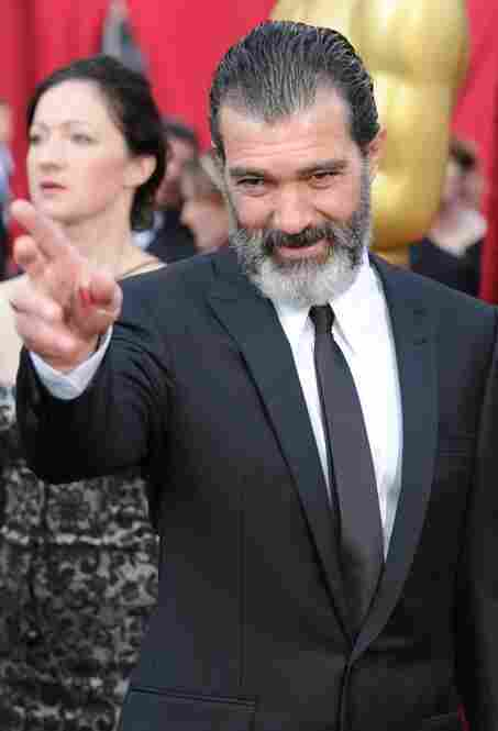 """To pass time on the red carpet, Antonio Banderas enjoys his two favorite hobbies: impersonating Fidel Castro and throwing darts at Ryan Seacrest."""