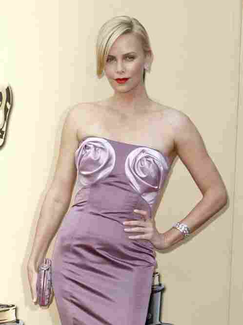 """""""Charlize Theron would like to remind you her eyes are UP HERE."""""""