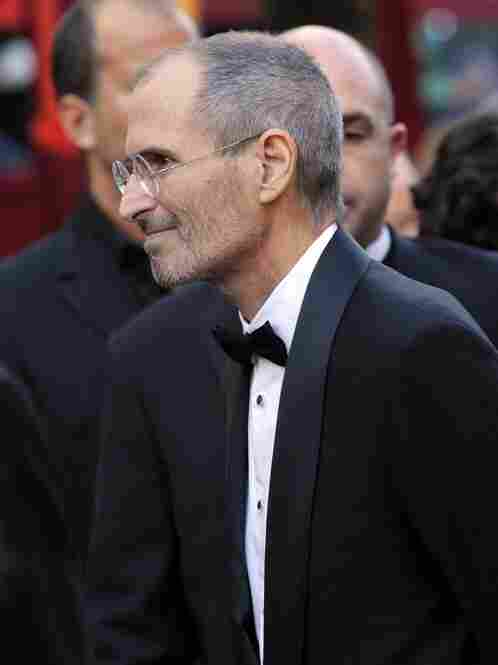 """For the occasion, Steve Jobs had a tuxedo printed on his black mock turtleneck and jeans."""