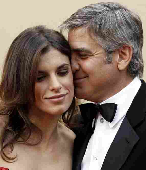 """Elisabetta Canalis models the new Cloontooth headset."" (The Italian model and actress is Clooney's current squeeze.)"