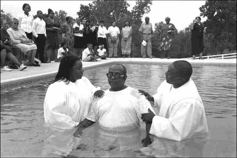 "Take Me to the River 2, 2005. ""The church is the soul of the community,"" Hoskins said over the phone. A man is baptized in a New Zion community member's pool. The creek in which it was supposed to take place was too murky."