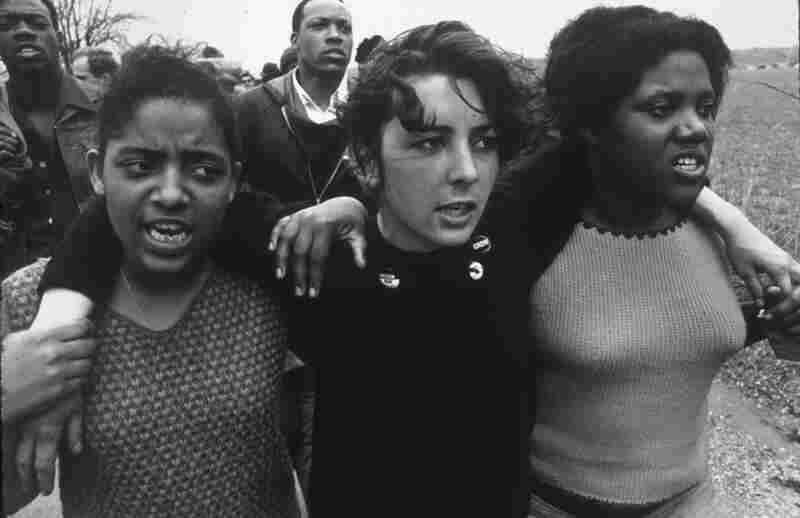 Three young women sing freedom songs as they march toward Montgomery, Ala., in the Selma to Montgomery March of 1965.