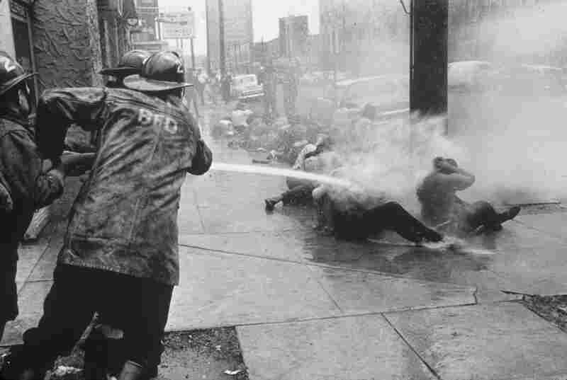 Firemen hose demonstrators with high-pressure jets of water. Birmingham, Ala., 1963