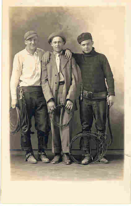 Three linesmen, most likely with communications cables