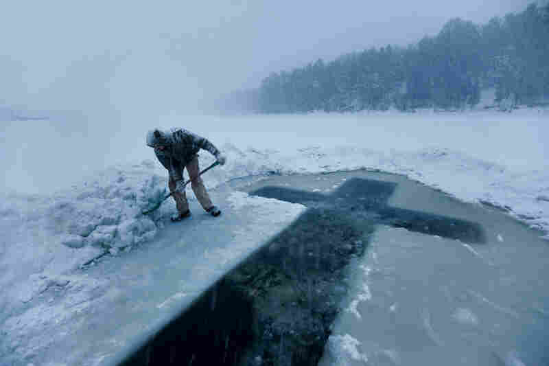 """""""A cross hewn for Epiphany in the ice of Maine's Kennebec River by parishioners of St. Alexander Nevsky Russian Orthodox Church commemorates the baptism of Christ."""""""