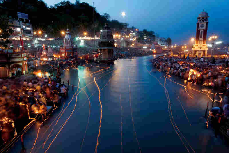 """""""India's holiest river, the Ganges, is scribbled with light from floating oil lamps during the Ganga Dussehra festival in Haridwar."""""""