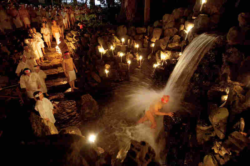 """The sacred waterfall at the Tsubaki Grand Shrine in Mie Prefecture, Japan, washes away impurities in the Shinto ritual known as misogi shuho."""