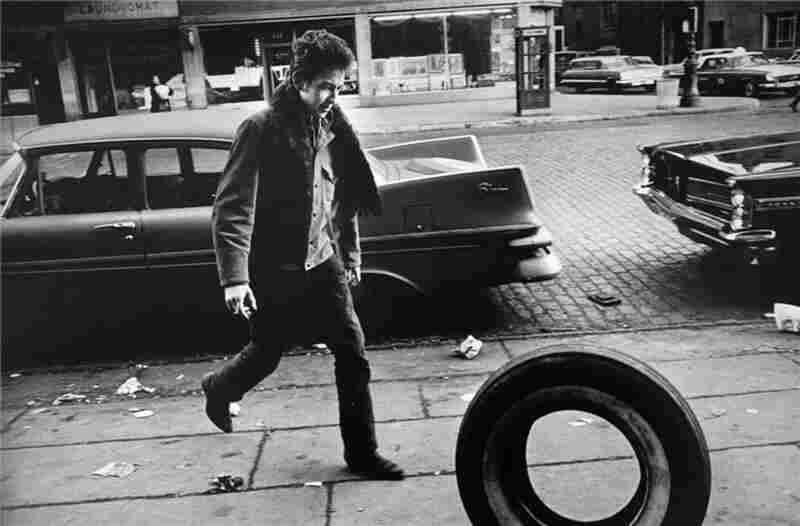 """Bob Dylan, 1963. """"This particular photo was taken one Sunday morning when Bobby, his girlfriend Suze Rotolo, Dave Van Ronk, and Terri Van Ronk were all going to breakfast in New York... I feel it shows Bob was still a kid in 1963,"""" Marshall wrote."""