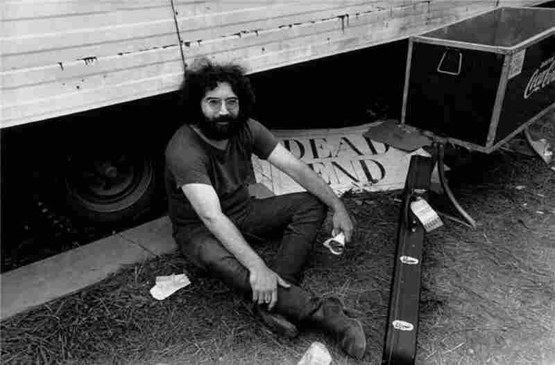 Jerry Garcia of the Grateful Dead backstage at Woodstock, 1969.