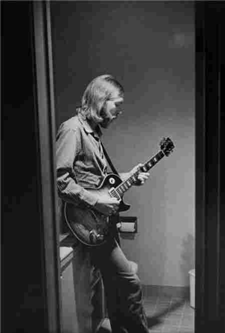 Duane Allman of The Allman Brothers Band practices in the bathroom of a Holiday Inn, 1971.