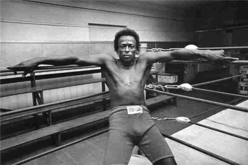 Miles Davis sits in a boxing ring at Newman's Gym in San Francisco, 1971.