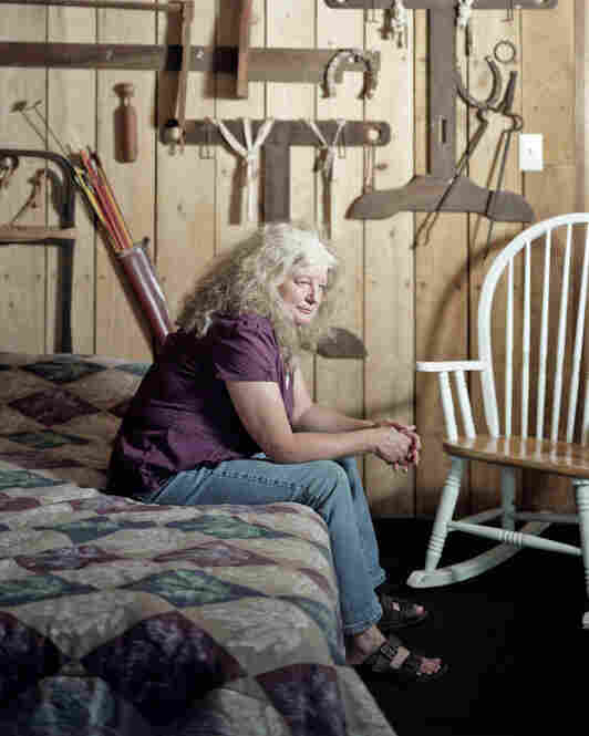 Cindy Parker, a resident of Rutland, Ohio, in Meigs County, sits in a cabin that houses her father's tools.