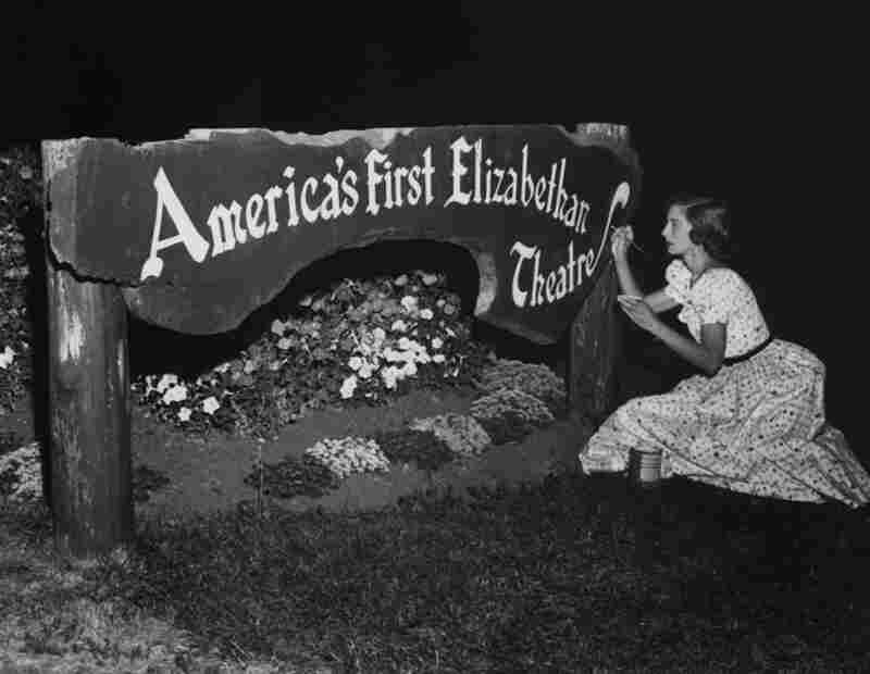 Oregon Shakespeare Festival volunteer Martha Dawkins turns a donated piece of wood into a sign in the early 1950s.