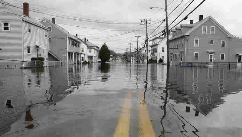 The houses along Providence Street in West Warwick, R.I., are vacant after being flooded by the Pawtuxet River on Wednesday. The Pawtuxet River hit a record of 20.7 feet.