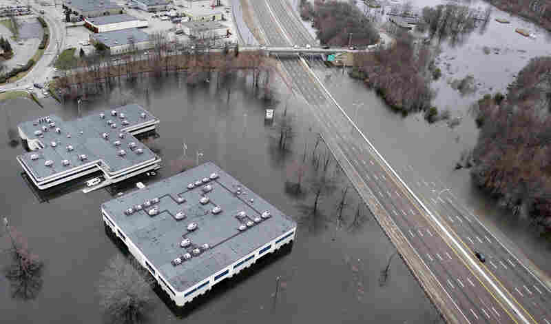 Two buildings in an office park are surrounded by floodwaters in Warwick, R.I. on Wednesday.