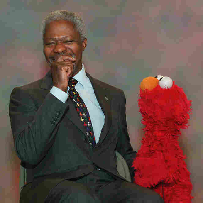 United Nations Secretary-General Kofi Annan laughs while taping a scene with Elmo during production of an episode of Sesame Street, Dec. 6, 2001. Annan offered Elmo a job at the United Nations and Elmo asked if he could win a Nobel prize, too.