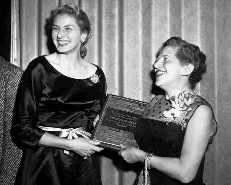 Swedish actress Ingrid Bergman (left) receives an award for best actress from Irene Thirer, chairman of the New York Film Critics, Jan. 19, 1957.