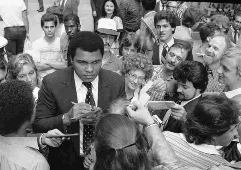 Former heavyweight champion Muhammad Ali signs autographs in New York, Sept. 15, 1982.