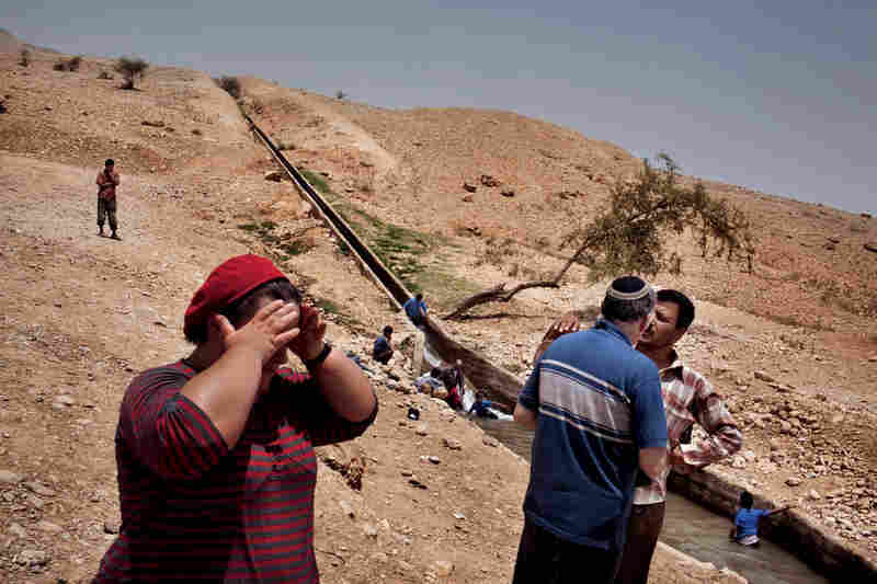 Tempers flare near Auja when a conversation between Israeli settlers and a local Palestinian turns to a debate over ownership of land and water. Fed by a natural spring, Auja's only water channel for farming runs dry every summer.
