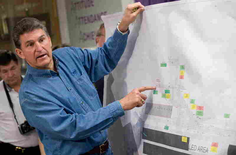 West Virginia Gov. Joe Manchin explains drilling locations on a map of the Upper Big Branch coal mine during a Wednesday news conference. The mine is owned by Massey Energy Co. and operated by Performance Coal Co.