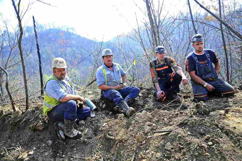 Massey Energy workers (from left) Maurice Blanchette, Jimmy Shortridge, Brandon Waddell and Andrew Lucas take a break from drilling efforts in Montcoal on Wednesday.