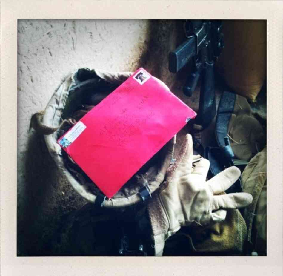 A letter rests in the helmet of a U.S. Marine after he and his platoon members received mail from home in Marjah in Afghanistan's Helmand province.