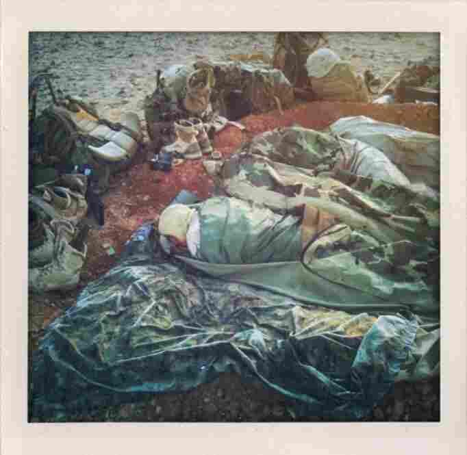 U.S. Marines sleep in fighting holes near Marjah.