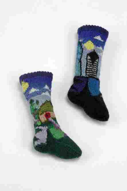 Althea Crome, who knit the clothes for the title character in the film Coraline, took 100 hours to hand-knit these 1.5-inch socks for the exhibit.