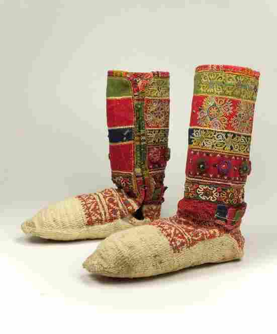 These 19th century Croatian socks are intricately embroidered and include metal and fabric sequins.