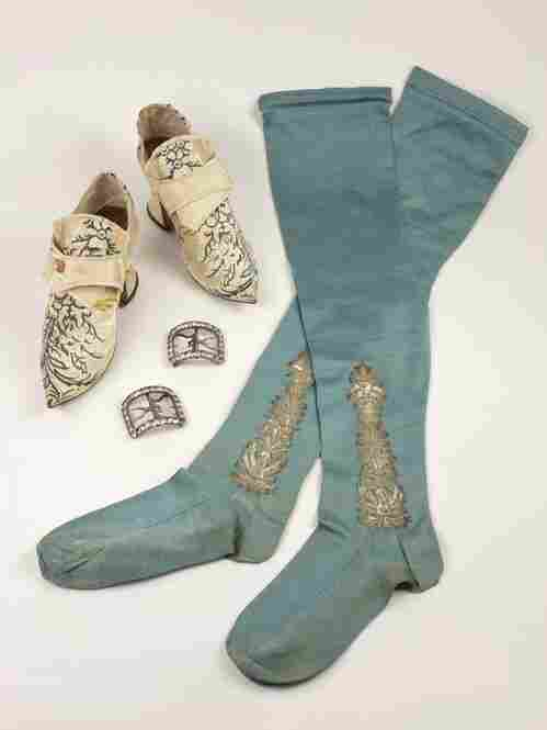 These blue stockings would have been fashionable during the mid-18th century.