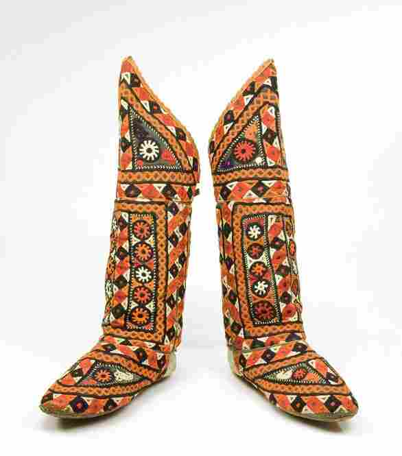People in 19th century northern Afghanistan wore these leather boot socks under their shoes while out walking or riding. But inside their homes, they padded around on carpet wearing the soft-soled socks.