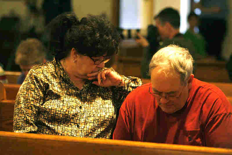 Parishoners gather to pray Tuesday for the miners lost or missing in an explosion at the Upper Big Branch mine in Montcoal.